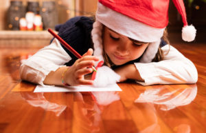 Christmas scene. girl writing a letter